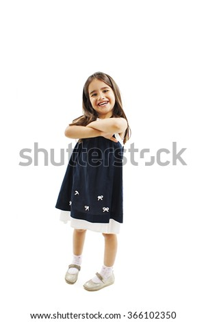 Full length portrait of a little girl standing with folded hand. Isolated on white background - stock photo