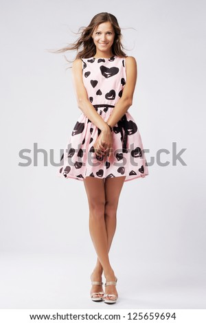 Full-length portrait of a lovely woman in romantic dress - stock photo