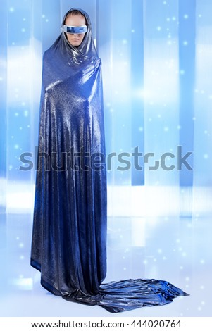 Full length portrait of a magnifiscent  young woman in silver latex costume over futuristic background. Sci-fi style. - stock photo