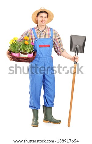 Full length portrait of a male agricultural worker holding a shovel and flowers isolated on white background - stock photo