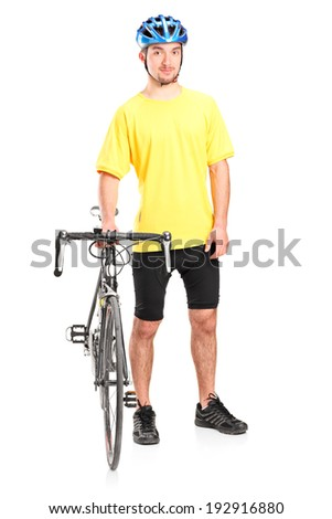 Full length portrait of a male biker posing with his bike isolated on white background - stock photo