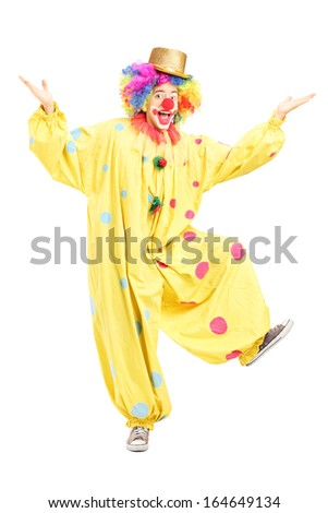 Full length portrait of a male funny circus clown posing isolated on white background - stock photo