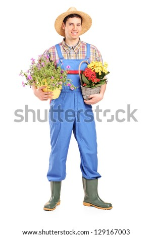 Full length portrait of a male gardener holding plants isolated on white background