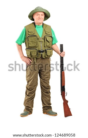 Full length portrait of a male hunter holding a shotgun isolated on white background