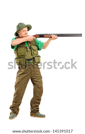 Full length portrait of a male hunter shooting with a rifle, isolated on white background