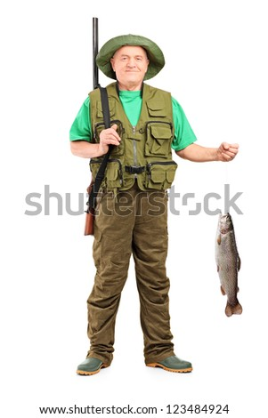 Full length portrait of a male hunter with rifle holding a fish isolated on white background - stock photo
