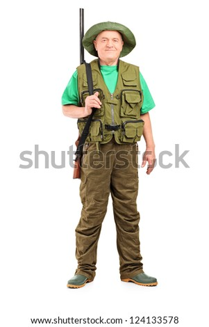 Full length portrait of a male hunter with shotgun posing isolated on white background