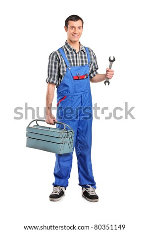 Full length portrait of a male manual worker holding a wrench and tool box isolated on white background