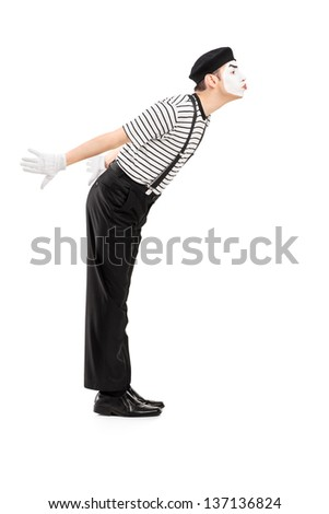 Full length portrait of a male mime artist gesture kissing isolated on white background