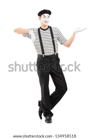 Full length portrait of a male mime artist gesturing with hand, isolated against white background - stock photo