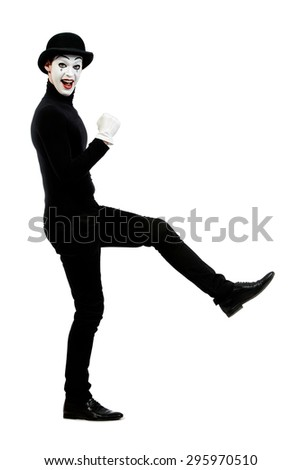 Full length portrait of a male mime artist performing different emotions. Isolated over white. - stock photo