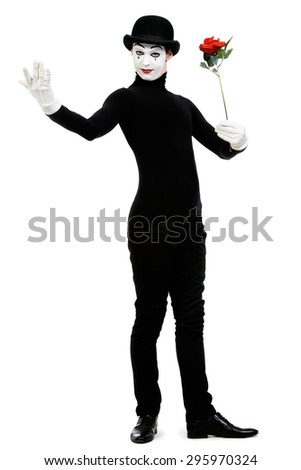 Full length portrait of a male mime artist with red rose performing different emotions. Isolated over white. - stock photo
