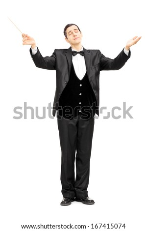 Full length portrait of a male orchestra conductor directing with baton isolated on white background - stock photo