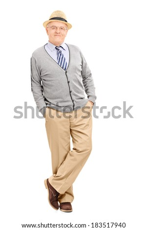 Full length portrait of a male pensioner leaning against a wall isolated on white background - stock photo