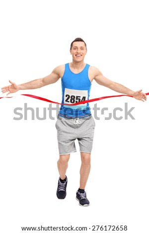 Full length portrait of a male runner with a race number on his chest, crossing the finish line isolated on white background - stock photo