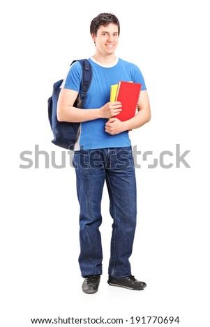 Full length portrait of a male student holding notebooks isolated on white background