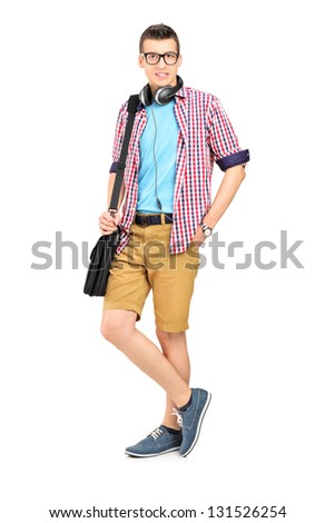 Full length portrait of a male student with a shoulder bag and headphones isolated on white background - stock photo