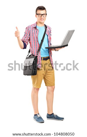 Full length portrait of a male student with a shoulder bag, with a laptop giving thumb up isolated on white background - stock photo