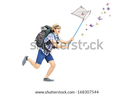 Full length portrait of a male tourist catching butterflies with net isolated on white background - stock photo