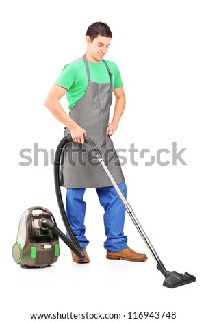 Full length portrait of a man cleaning with vacuum cleaner isolated against white background