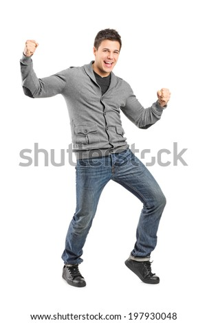 Full length portrait of a man gesturing happiness isolated on white background - stock photo