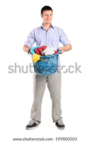 Full length portrait of a man holding a basket full of laundry isolated on white background