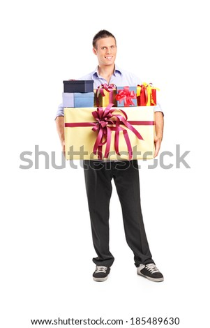 Full length portrait of a man holding a bunch of presents isolated on white background - stock photo