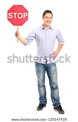 Full length portrait of a man holding a traffic sign stop isolated on white background - stock photo