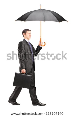 Full length portrait of a man holding an umbrella and briefcase isolated on white background - stock photo