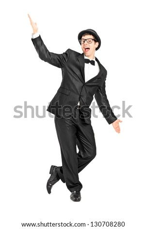 Full length portrait of a man in a bow tie suit dancing isolated on white background - stock photo