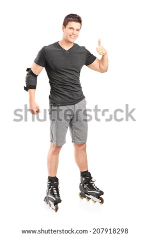 Full length portrait of a man on roller skates giving a thumb up isolated on white background - stock photo