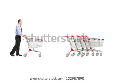 Full length portrait of a man returning an empty shopping cart isolated on white background