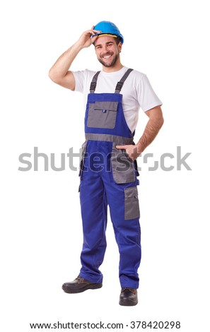 Full length portrait of a manual worker with blue helmet and uniform - stock photo