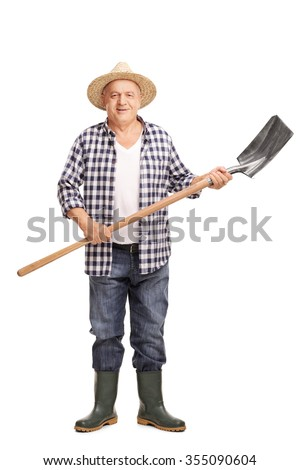Full length portrait of a mature agricultural worker holding a shovel and looking at the camera isolated on white background - stock photo