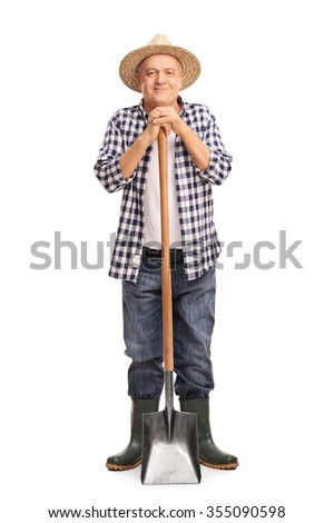 Full length portrait of a mature agricultural worker posing with a shovel isolated on white background - stock photo