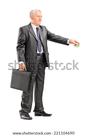 Full length portrait of a mature businessman giving money to someone isolated on white background - stock photo