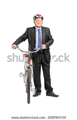 Full length portrait of a mature businessperson holding a bicycle, isolated on white background - stock photo