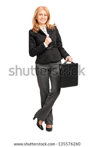 Full length portrait of a mature businesswoman leaning against a wall, isolated on white background - stock photo