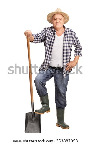 Full length portrait of a mature farmer posing with a shovel isolated on white background - stock photo