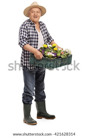 Full length portrait of a mature gardener holding glowers and looking at the camera isolated on white background - stock photo
