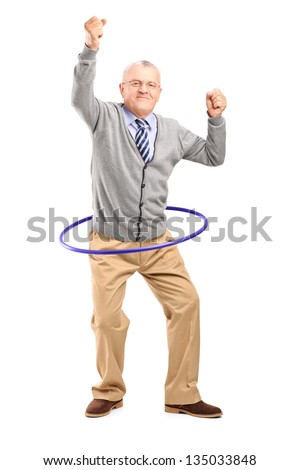 Full length portrait of a mature gentleman dancing with a hula hoop isolated on white background - stock photo