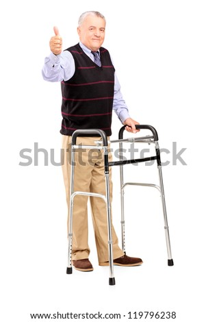 Full length portrait of a mature gentleman using a walker and giving a thumb up isolated on white background - stock photo