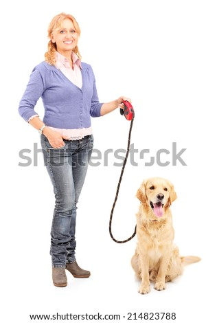 Full length portrait of a mature lady holding a dog on a leash isolated on white background