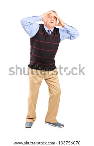 Full length portrait of a mature man holding his head in pain isolated on white background - stock photo