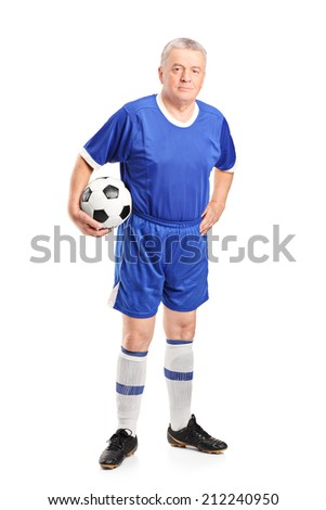 Full length portrait of a mature man in sportswear holding a football isolated on white background - stock photo