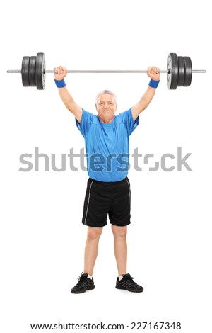 Full length portrait of a mature man in sportswear holding a heavy weight isolated on white background - stock photo