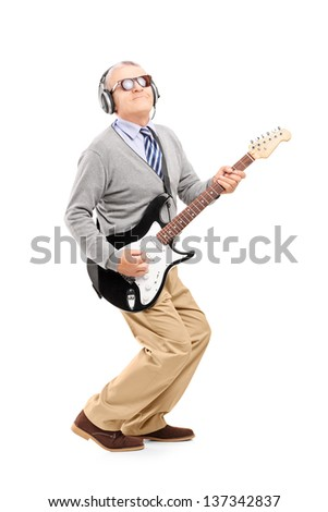 Full length portrait of a mature man playing guitar isolated on white background