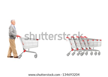 Full length portrait of a mature man returning an empty shopping cart, isolated on white background - stock photo