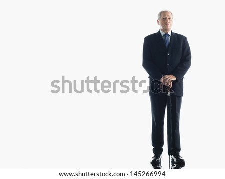 Full length portrait of a middle aged businessman with umbrella against white background