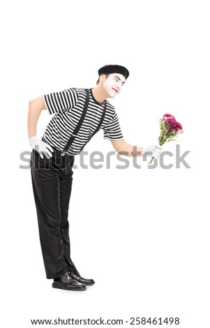 Full length portrait of a mime artist giving flowers to someone isolated on white background - stock photo